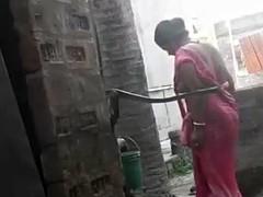 Voyeur - Indian BBW bathes..